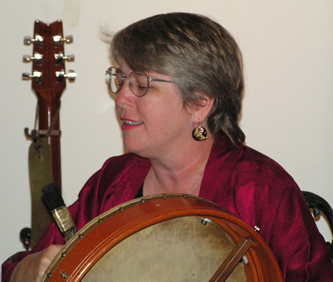 Brenda, playing bodhran at the Phoenix and Dragon Bookstore
